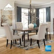 tripton rectangular dining room table 4 uph side chairs by signature design by ashley get your tripton rectangular dining room table 4 uph side chairs