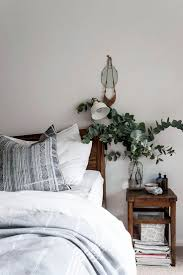 Soothing mix of gray, white and wood in the bedroom, with an arrangement of  fresh cut silver dollar eucalyptus. (Mix Wood In Living Room)