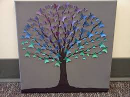 recycled paper tree gray background purple blue teal green erflies made from paint swatches