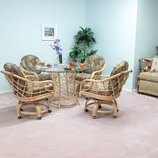 Light Brown Rattan Chairs With Bars On The Back Combined With - Casters for dining room chairs
