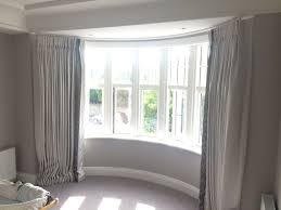 Curved bedroom curtain bay window with zoffany trim.