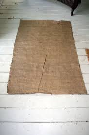 I'm going to make a burlap rug with a huge painted flower on it