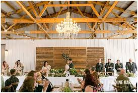 the round barn jeannine wedding reception chandelier head table fl decor greenery rustic decor
