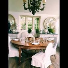 english country dining room with simple linen slipcovered chairs home of paolo moschino nicholas