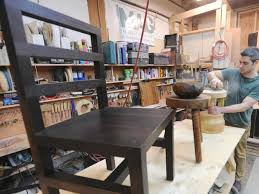 craftsmen furniture. craftsman jeff martin works on a piece of handmade furniture at his vancouver workshop craftsmen