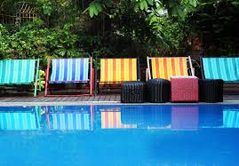 pool furniture ideas. deck chair and furniture next to a swimming pool ideas d