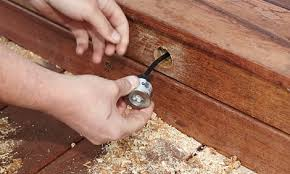 decking lighting ideas. Person Installing The Deck Lights Decking Lighting Ideas
