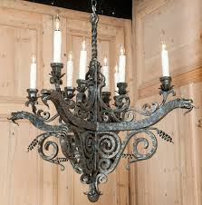 wrought from red hot iron this intriguing chandelier features a decidedly meval look