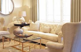 smaller living rooms do best if they are decorated with simplicity a beautiful beige sofa a dark beige rug with a transpa table and khaki walls all