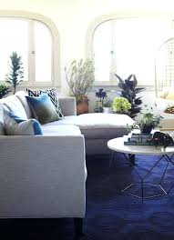 solid blue rug living room with grey couch navy gray pattern blue grey couch pouf on carpet