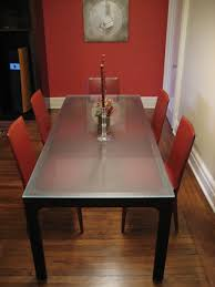elegant narrow dining room table set modern red dining chairs minimalist rectangular glass top dining table white red painted wall tall glass candle holder