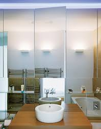 dwell bathroom ideas dwell  how to make the most of a tiny bathroom dwell bruce and kirsty are obsessively tidy so copious storage was must an entire bathroom small mirrors bathroom bathroom light fixtures small design storage c