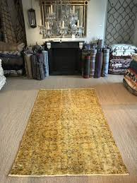 ochre yellow overdyed turkish rug vintage reloaded carpet medium size