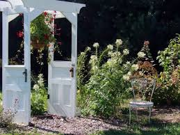 recycling old wooden doors garden arbor flowers white chair repurposed patio ideas