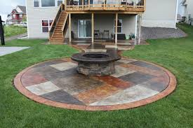 stamped concrete patio with fireplace. Stamped Concrete Patio With Fire Pit Stained A Stone Wrapped Fireplace D