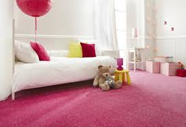 charming girls bedroom with pink pillow and teddy bear doll and pink carpet and yellow chair charming kid bedroom design