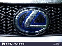 lexus logo. silver blue lexus (car brand) logo covered with rain. - stock image