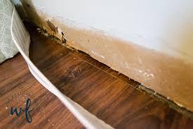 installing vinyl plank flooring in laundry room 9