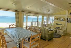 The Living And Dining Room Of South Beach Suite #14 At The Crystal Cove Beach  Cottages Is Open And Airy And Decorated With Beach Accommodating Pieces.