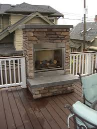 outdoor fireplace on wood deck