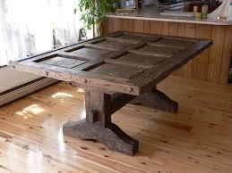 distressed wood dining table with rustic reclaimed old door top on diy show off barn door