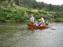 classic wood drift boat fly fishing