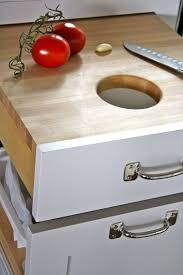 kitchen drawer pull out cutting board with a hole in the middle for