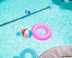 swimming pool beach ball background. Bright Pink Float And Beach Balls In Blue Swimming Pool, Floating  Refreshing Pool With Ball Background