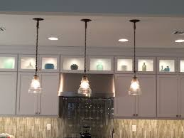 backsplash lighting. rope pendants led transom cabinet lighting glass and stone vertical mosaic tile backsplash