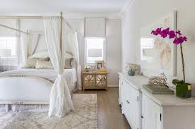 Soothing White Master Suite Features Gold, Marble Decor | Marie ...