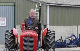 Jeremy clarkson inside the cab of his £40,000 lamborghini tractor in clarkson's farm. 0zkazjk3swcgzm