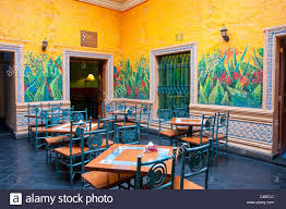 a restaurant table and chairs in arequipa peru south america with south  american interior design.