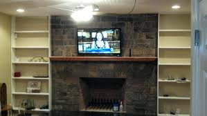 fireplace mounting tv over brick fireplace hiding wires install on rock with above hanging flat screen