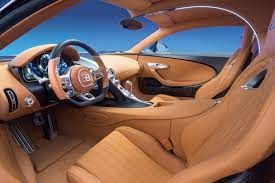 The vehicle features redesigned front grille, a black background for the headlights, side mirrors and more. Interior Design Reduction To The Essentials Bugatti Newsroom
