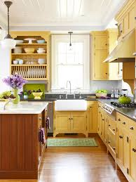 yellow kitchen cabinets and warm wood floor
