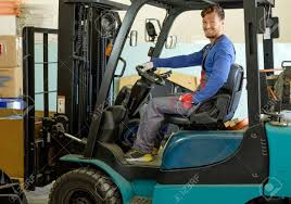 Man Driving Forklift Truck On A Warehouse Stock Photo Picture And