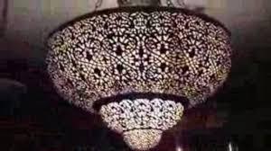 chandelier in spanish moroccan lighting moorish lantern cooker hood nursery style outdoor light fixtures brass iron words to retractable
