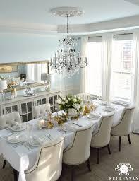 big crystal chandelier in blue dining room