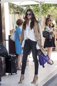 trench coat white on down shirt skinny jeans and high heels