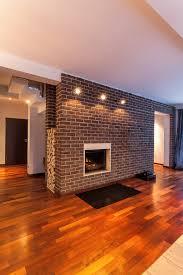 modern living room with brick fireplace. Brick Fireplace With A Modern Twist Living Room