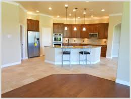 tile versus hardwood floors in kitchen morespoons 151a47a18d65 throughout or wood idea 19