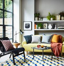 living room yellow sectional sofa set white large bookcase fabric black accent chair coffee table small round wood side lamp bookshelves gray wall hexagon