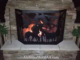 custom outdoor fireplace screen with monogram and horse scene