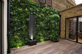 green wall lighting. Garden Design Photography, Small Couryard With Artificicial Green Wall, Bespoke Water Feature, Wall Lighting