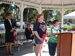 students lead the way at annual plant city veterans day program james robinson of pinecrest elementary school delivers his essay while shelby paulsen waits her turn at