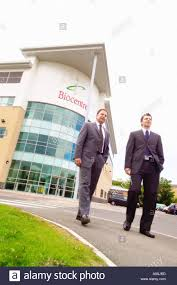 two businessmen walking from biocentre building at york science York Science Park Map stock photo two businessmen walking from biocentre building at york science park heslington york york science park map