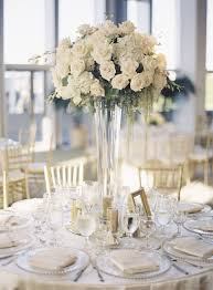 wedding table decorations with round table be equipped glass and flower centerpieces for wedding reception which uses light purple