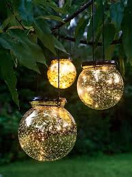 led fairy dust ball outdoor battery operated globe lights mercury glass globes by day they re shiny golden orbs at night pinpoints of light emerge like