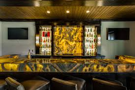 backlit bar featuring aria stone gallery s onyx nuvolato designed by m2 designs