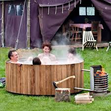 installed at amsterdam s droog hotel weltevree s wood fired hot tub combines savvy dutch design with nature s innately handsome aesthetics